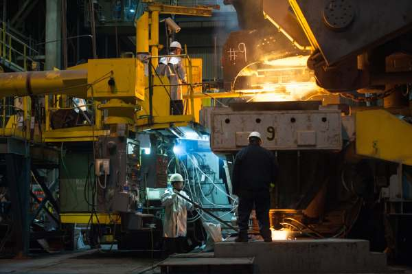 Molten steel is poured into molds in the caster to make steel slabs at the JSW Steel Ohio plant, Thursday, Feb. 14, 2019, in Mingo Junction, Ohio. Many employees have never stepped foot in a steel mill, so the company called back steelworkers who lost their jobs when the plant closed in 2008 to train the next generation.