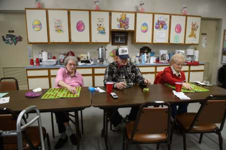 """""""If that mill gets back to full production, that means more money coming back down,"""" says Fred Pernick, 83, director of the Mingo Junction Senior Center, who hopes the city's funds available to donate to the senior center will increase, as well. He plays bingo, which raises money for the center, with Barbara Jackson, left, 87, and Millie Huggins, 77."""