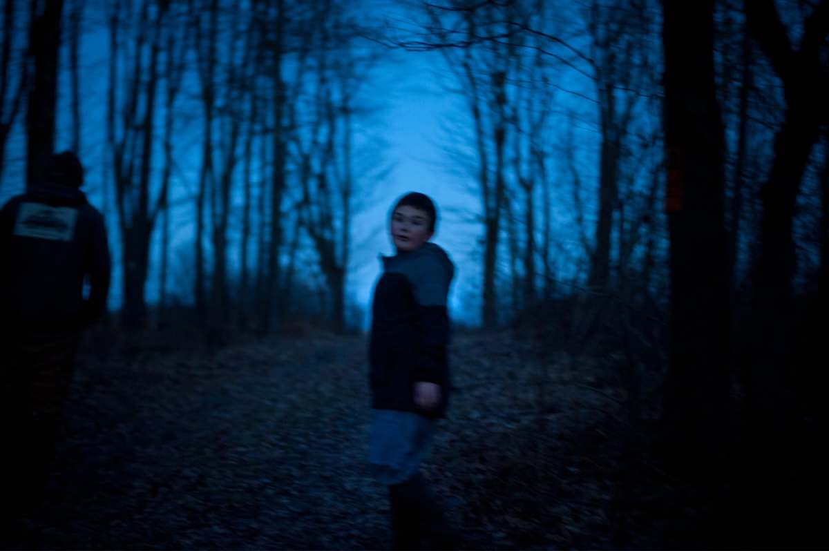 "Anthony walks home from the farm pond at dusk in Jan. In the beginning of December as the strain from his mother's cancer mounted, Anthony told her that life is mostly bad. ""I told him, 'I never want to hear that again,'"" said his mother, Mary Beth Brown. ""They're watching how I'm reacting...We tell them, 'God has a reason for everything. Sometimes you don't see it for years.'"""