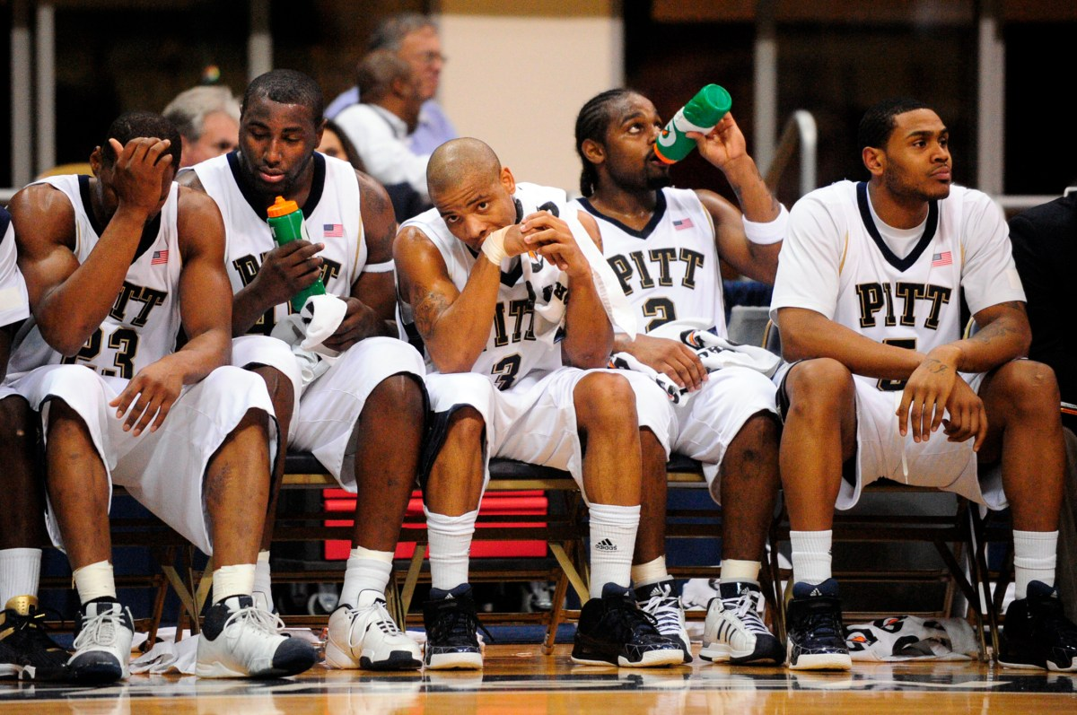 Pitt players, from left, Sam Young, DeJuan Blair, Jermaine Dixon, LeVance Fields and Tyrell Biggs sit on the bench during a game Feb. 2, 2009, against Robert Morris at the Petersen Events Center. (John Heller/Post-Gazette)