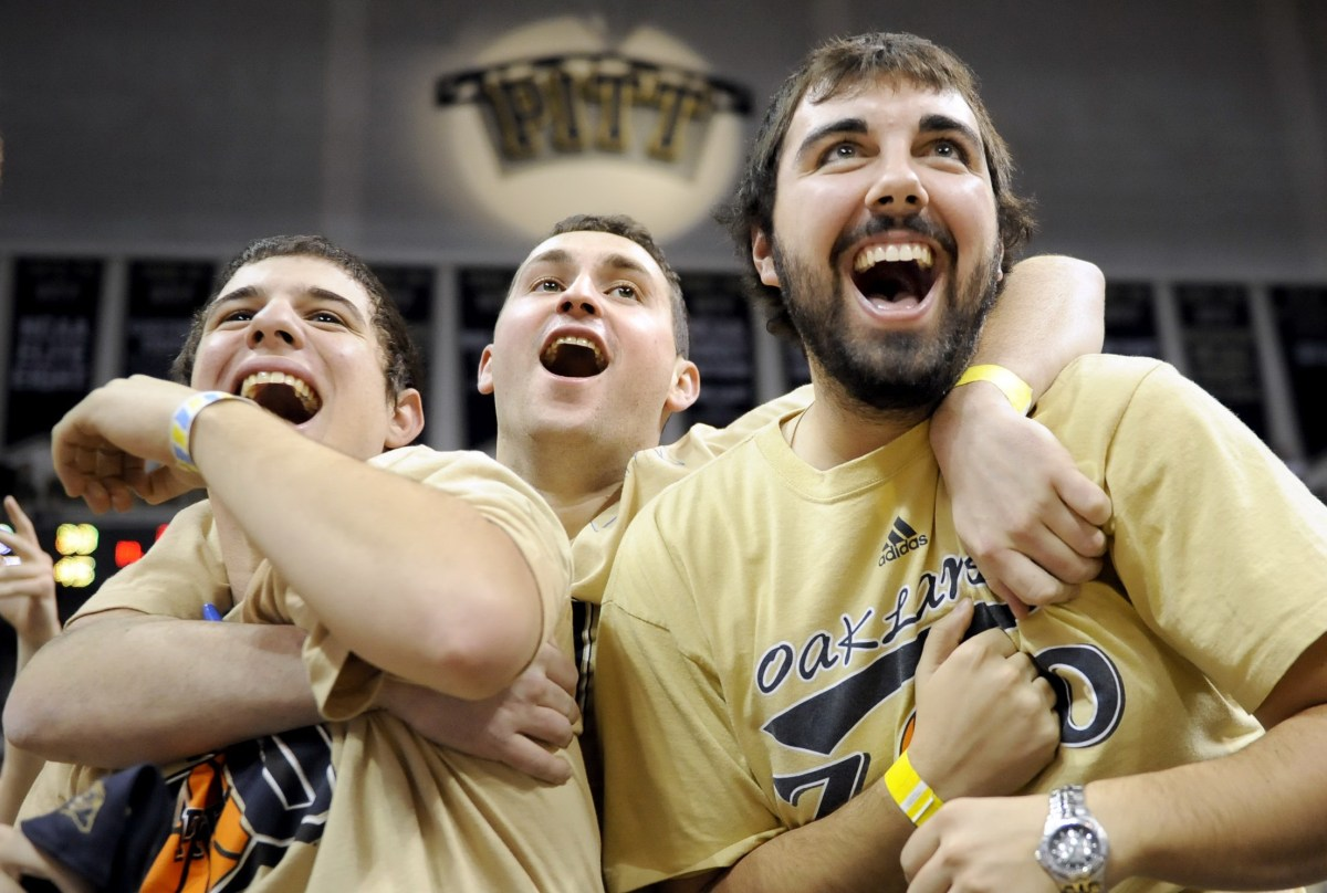 Pitt students celebrate after a Sam Young dunk against Duquesne on Dec. 3, 2008, at the Petersen Events Center. (Matt Freed/Post-Gazette)