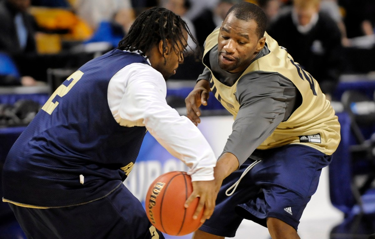 Sam Young plays defense on teammate Levance Fields in practice on March 25, 2009, before Pitt faced Xavier in the Sweet Sixteen in the NCAA tournament in Boston. (Matt Freed/Post-Gazette)
