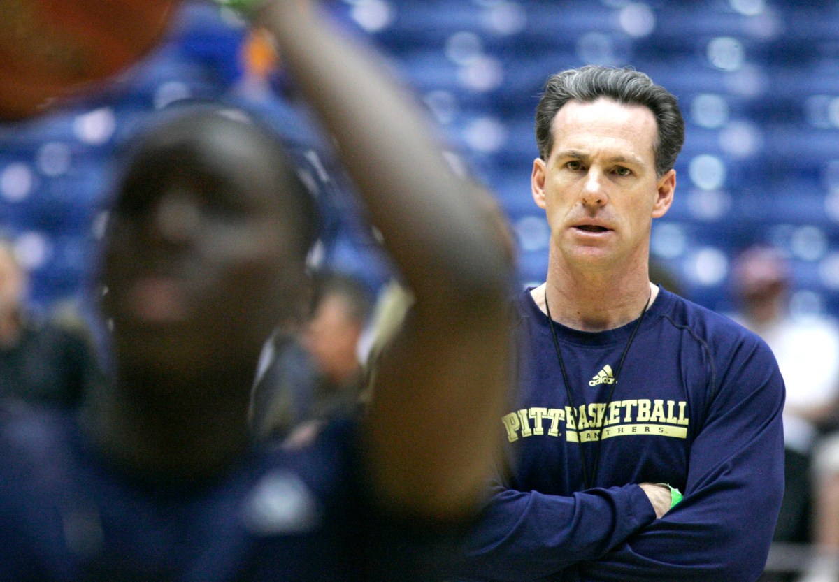Pitt coach Jamie Dixon, right, watches practice at the men's NCAA college basketball tournament Thursday, March 19, 2009, in Dayton, Ohio. Pittsburgh plays East Tennessee State in the first round on Friday. (AP Photo/Al Behrman)