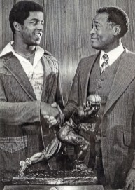 Herb Douglas Jr., right, congratulates Tony Dorsett, winner of the Heisman Trophy, 1976. (Courtesy of Heinz History Center)