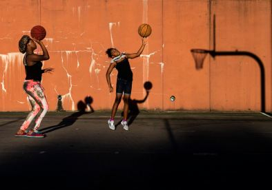 Cousins Jazmier Moss, left, 13, of Allentown, and Chalise Ramey, 10, of Mt. Washington, shoot hoops together, Friday, Sept. 4, 2020, at Warrington Recreation Center in Beltzhoover. (Steph Chambers/Post-Gazette)
