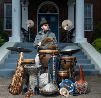 "Drummer George Heid III performs in front of his home Wednesday, April 15, 2020, in Aspinwall. Mr. Heid, who has lived and performed in China, said he was working six-nights a week before the coronavirus brought everything to halt. ""I'm just taking this time to work on my music,"" he said. (Nate Guidry/Post-Gazette)"
