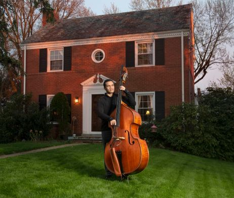 "Paul Thompson plays his upright bass outside his home Tuesday, April 14, 2020, in Greentree. Thompson, who teaches music at the Pittsburgh Creative and Performing Arts, (CAPA), said he is taking this time of self-quarantine to work on some of his music. ""I've always wanted to record an album,"" said Mr. Thompson. ""I'm going to take this time to finally do it."" (Nate Guidry/Post-Gazette)"