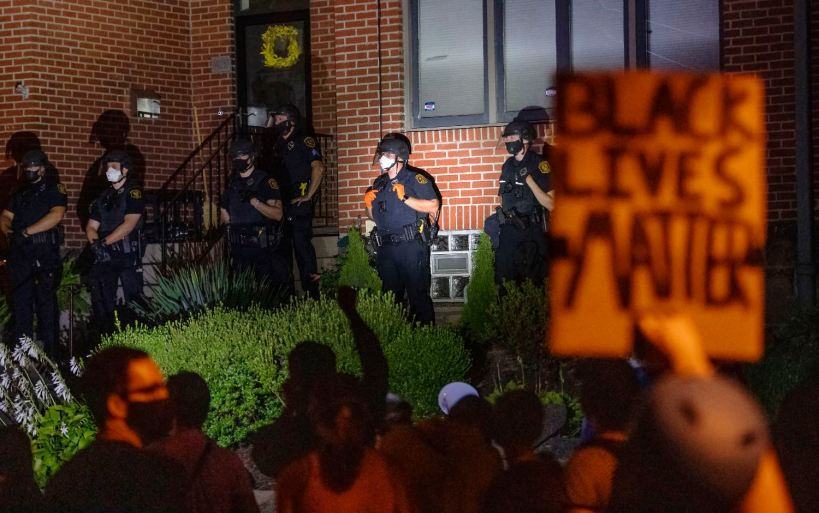 "Police stand guard outside Mayor Bill Peduto's residence as protestors chant for him to address racial inequality in the wake of charges filed against four Black Lives Matter protest leaders, Saturday, Sept. 5, 2020, in Point Breeze. ""Last time I sat on my porch & welcomed protestors with dialogue. They chose to end it,"" Mr. Peduto wrote on Twitter later in the night. ""Together, we work with our Black Community to reimagine policing in our city. Pittsburgh remains open to any & all ideas to work together to create a better city."" (Emily Matthews/Post-Gazette)"