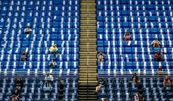 Students attend Professor Peggy Van Meter's education class in the 16,000-seat Bryce Jordan Center at Penn State University, Thursday, Oct. 8, 2020, in State College. Her 100-person introductory class is one of a small handful that rotate in and out of the cavernous event center, repurposed this semester for socially distanced instruction.(Andrew Rush/Post-Gazette)