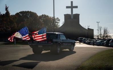 A supporter of President Donald Trump arrives at a polling location at Cornerstone Ministries on Election Day, Tuesday, Nov. 3, 2020, in Export. Vice President Mike Pence visited the church in September. (Andrew Rush/Post-Gazette)