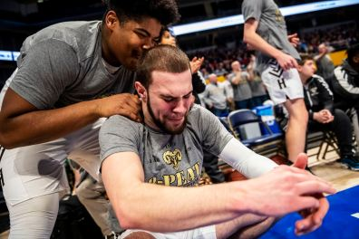 Wahkeem Roman, of Highlands, left, talks to Luke Cochran, right, as he is overcome with emotion during the Belle Vernon at Highlands WPIAL Class 4A Boys High School Basketball Championship, Saturday, Feb. 29, 2020, at Petersen Events Center in Oakland. (Michael M. Santiago/Post-Gazette)
