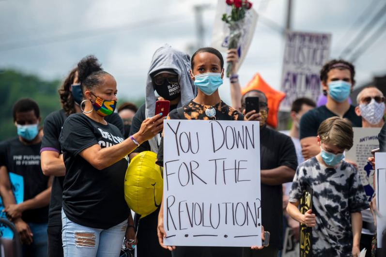 People listen to speakers as they gather near the site where Antwon Rose II was killed on the two-year anniversary of his death, Friday, June 19, 2020, on Linden Avenue in East Pittsburgh. The day also marked Juneteenth, the holiday that commemorates the ending of slavery in the U.S. (Michael M. Santiago/Post-Gazette)