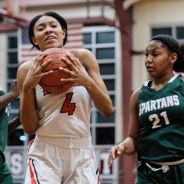 Rogers' Logen Love (4) pulls in a rebound against Start's Alasia Easley (21) during the girls City League championship basketball game Thursday, February, 14, 2019, in Toledo, Ohio. Rogers defeated Start 52-50.THE BLADE/JEREMY WADSWORTH SPT CLfinal15p