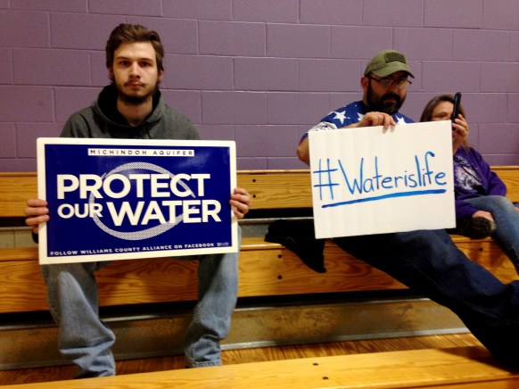 L to r Dustin Wilson, 19, of Fayette, and Blaise Vallejo, 35, of Fayette. People concerned about future usage of the nine-county Michindoh Aquifer attend the Tuesday night public information session hosted by the Ohio Environmental Protection Agency. The public information session is about Artesian of Pioneer's plans to drill a production well near the Fulton County village of Fayette, Ohio. THE BLADE/TOM HENRY Aquifer13