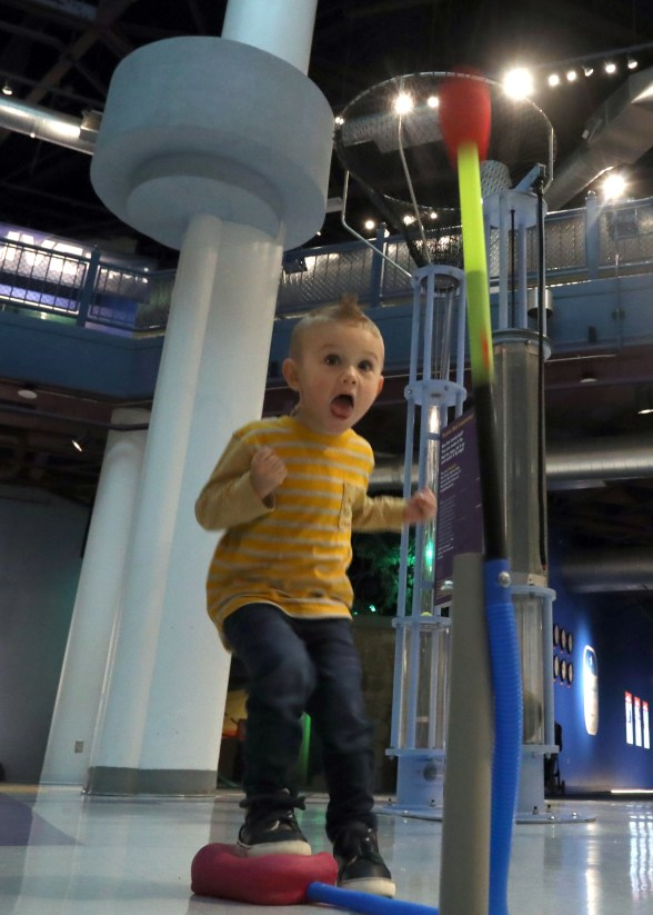"Jude Sistrunk, 2, watches while he blasts a paper rocket that he made into the air during a ""Little Scientists"" event at the Imagination Station on Thursday, March 14, 2019. THE BLADE/AMY E. VOIGT CTY scientists13p"
