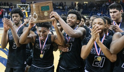 Start players celebrate defeating Whitmer, 30-31, to win a Division I boys district final basketball game Saturday, March 9, 2019, at Savage Arena in Toledo, Ohio. Start defeated Whitmer, 31-30. THE BLADE/JEREMY WADSWORTH SPT D1districtBBK10p