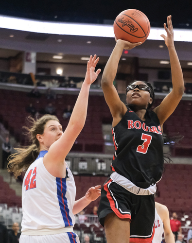 Rogers' Madison Royal-Davis shoots against Dayton Carroll's Julia Keller (42) during a girls Division II State Championship basketball game Saturday, March 16, 2019, at the Jerome Schottenstein Center in Columbus, Ohio. THE BLADE/JEREMY WADSWORTH SPT D2stateGBK17