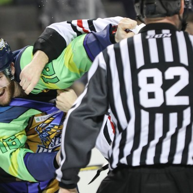 Toledo Walleye's Bryan Moore (16) fights Indy Fuel's Eric Schurhamer (5) during the third period of an ECHL hockey game at the Huntington Center in downtown Toledo, Ohio on Sunday March 3, 2019. THE BLADE/REBECCA BENSON