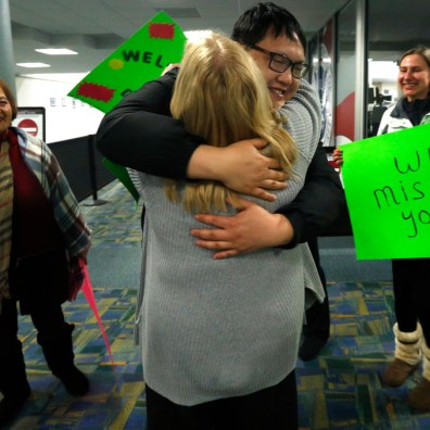 Tea Tree Asian Bistro owner Don Yi hugs faithful customer Lana Morse after his arrival to the Toledo Express Airport. THE BLADE/LORI KING