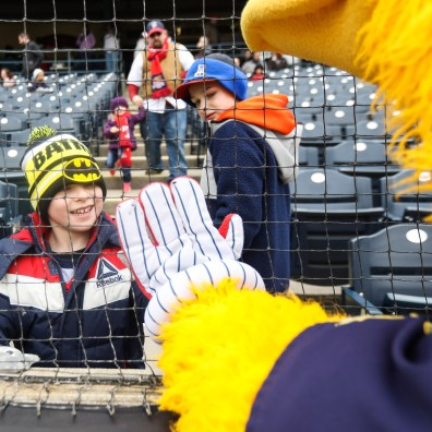 Peter Smith gives a high five during Opening Day for the Toledo Mud Hens at Fifth Third Field in downtown Toledo, Ohio on Thursday April 4, 2019. THE BLADE/REBECCA BENSON