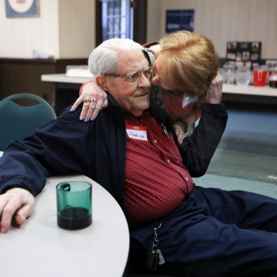 Marion Risk, left, gets a hug from friend Nila Jobe, right, during his 100th birthday party at Collingwood Presbyterian Church on Sunday, April 28, 2019. THE BLADE/AMY E. VOIGT