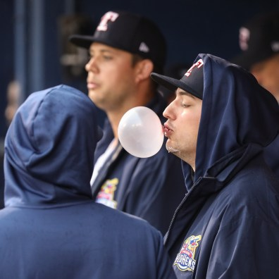 Toledo Mud Hens pitcher John Schreiber blows bubble sin the dugout during a baseball game agains the Columbus Clippers Thursday, May 3, 2019, at Fifth Third Field in Toledo, Ohio. THE BLADE/JEREMY WADSWORTH