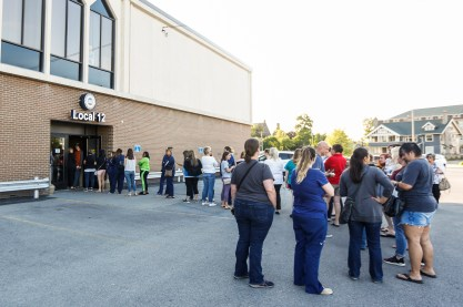 Nurses wait in line to enter the UAW Local 12 before the UAW informational meeting in Toledo, Ohio on Friday June 14, 2019. Striking Mercy Health St. Vincent Medical Center nurses from UAW Local 2213 held their first UAW informational meeting in advance of their contract vote next week. THE BLADE/REBECCA BENSON