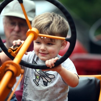 Henry Konrad, 2, pretends to drive a 1951 Minneapolis Moline model R tractor during the Power of Yesteryear Tractor Show at the Wood County Historical Museum on Sunday, June 9, 2019. THE BLADE/AMY E. VOIGT