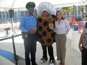 """Julio Navedo, center, has been performing as the hotel's """"Doubletree cookie"""" character, participating in numerous activities related to the hotel and the community. To the right is San Juan Mayor-elect Carmen Yulín Cruz."""
