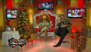 "Antulio ""Kobo"" Santarrosa alter-ego, ""La Comay,"" and sidekick Héctor Travieso during a recent airing of Puerto Rico's top-rated television show, ""SuperXclusivo."" (Credit: WapaTV.com)"