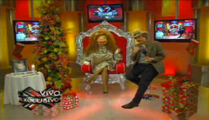 """Antulio """"Kobo"""" Santarrosa alter-ego, """"La Comay,"""" and sidekick Héctor Travieso during a recent airing of Puerto Rico's top-rated television show, """"SuperXclusivo."""" (Credit: WapaTV.com)"""