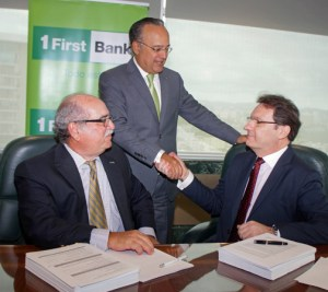 From left: Dacio Pasarell, chief banking operations officer of FirstBank; FirstBank President Aurelio Alemán; and Marcelo Annarumma, managing director, FIS Latin America and Caribbean.