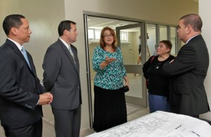 Banco Popular and RIncón Health Center executives walk through the future health facility.