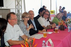 PRHTA President Clarisa Jiménez, with microphone, offers details of the Saborea event.