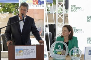 Cabo Rojo Mayor Roberto Ramírez speaks, while Tourism Company Executive Director Ingrid Rivera-Rocafort listens on.