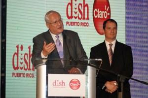 DISH Network Corp. CEO Joseph P. Clayton (at podium) and Claro Puerto Rico President Enrique Ortiz de Montellano speak during Tuesday's presentation.