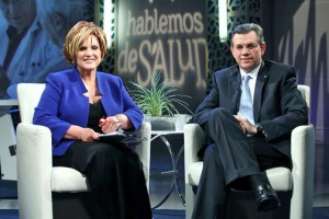"Journalist Carmen Jovet and Triple-S President Pablo Almodóvar on the set of ""Hablemos de Salud."""
