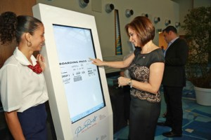 Tourism Co. Executive Director Ingrid Rivera-Rocafort, demonstrates an interactive element of the agency's campaign during its presentation at the Puerto Rico Convention Center
