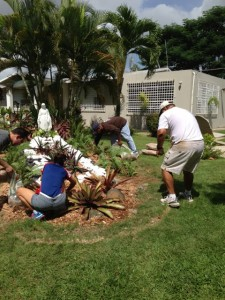 Volunteers work on the landscaping at the Hogar de Niñas home in Cupey.