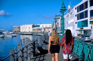 Tourists stroll along the Careenage in Bridgetown, Barbados. (Credit: Larry Luxner)