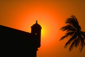 Dramatic sunset over an ancient sentry box in the Caribbean port of Cartagena. (Credit: Larry Luxner)