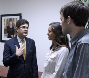 P.R. Trade Executive Director Francisco Chévere and AIESEC members talk following the signing of the agreement Thursday.