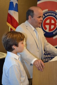 Eniel Torres-Ojeda, president of Productos La Finca, during his award acceptance speech this morning at SBA's Small Business Week Awards Ceremony.  With him, his son Adrián.