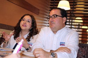 From left: Ana Agrelot, vice president of marketing of Encanto Restaurants and Humberto Rovira, company CEO, discuss plans for the IHOP chain.