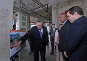 """From left: Gov. García-Padilla, U.S. Transportation Secretary Anthony Foxx and Puerto Rico Transportation Secretary Rubén Torres review the plans for the """"Sciences Boulevard"""" project."""