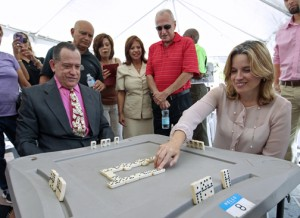 San Juan Mayor Carmen Yulín Cruz tries her hand at dominoes, going against XXX.