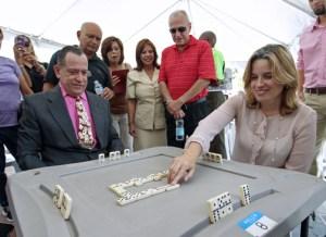 San Juan Mayor Carmen Yulín Cruz tries her hand at dominoes, going against XXX.