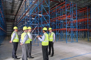 Local and stateside Nestlé officials tour Payco Foods' new Bayamón headquarters.