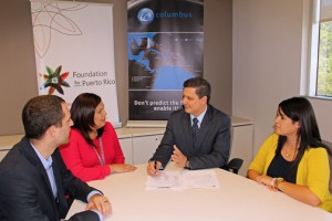 From left: Puerto Rico Foundation executives Josh Olmsted and Damaris Ocasio, Columbus Business Solutions General Manager Félix Lugo, and Yarillys Torres, services liaison for the Foundation, during the signing of the agreement.