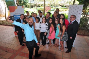 "A group of students pose for a ""selfie"" with Sacred Heart University Gilberto Marxuach-Torrós (far left) and Ray Flores, AT&T Puerto Rico regional vice president, (far right.)"